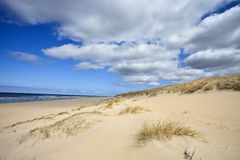 Sand dunes near to the sea Royalty Free Stock Images