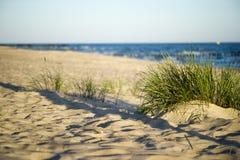 Sand dunes near to the sea Stock Photo