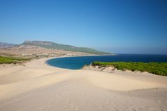 Sand dunes over Bolonia beach Stock Image