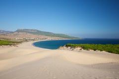 Sand dunes over Bolonia beach Stock Image