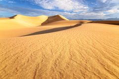 Sand dunes over sunrise sky in Death Valley. California Stock Image
