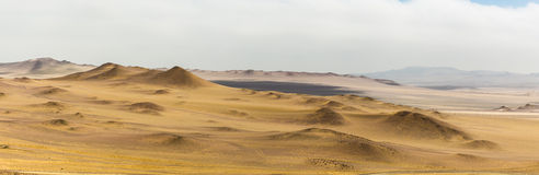 Sand dunes in the panoramic photo Royalty Free Stock Image