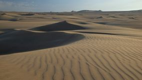 Sand dunes in Peruvian desert before sunset. royalty free stock images