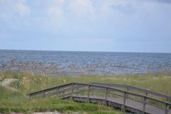Sand dunes protect the beach from the constant wind that sweeps the island shoreline stock photography