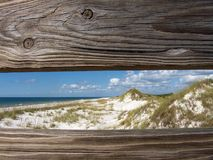 Sand Dunes Through a Railing. Looking through the railing of boardwalk access to the Gulf of Mexico in St. Joseph Peninsula State Park, Florida Stock Photography