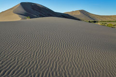 Sand dunes and ripples with a blue sky Stock Images