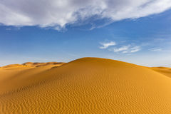 Sand dunes with ripples. And cloudy sky at Erg Chebby, Merzouga, Morocco Stock Photography