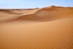 Sand dunes in Sahara. Royalty Free Stock Photo
