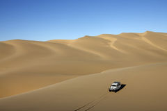 Sand dunes - Sandwich Harbor - Namibia. Driving on sand dunes at Sandwich Harbor in the Namib-nuakluft Desert in Namibia Stock Photos