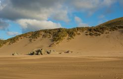 Woolacombe Sand near Barnstaple, Devon, England. Sand dunes and sandy beach at Woolacombe Sand near Barnstaple in North Devon, England Royalty Free Stock Images