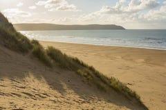 Woolacombe Sand near Barnstaple, Devon, England. Sand dunes and sandy beach at Woolacombe Sand near Barnstaple in North Devon, England Royalty Free Stock Image