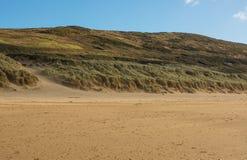 Woolacombe Sand near Barnstaple, Devon, England. Sand dunes and sandy beach at Woolacombe Sand near Barnstaple in North Devon, England Royalty Free Stock Photo