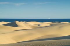 Sand dunes and sea Stock Images