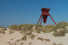 Sand dunes with seamark. Seamark in sand dunes in Blokhus Denmark Royalty Free Stock Photos