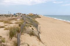Sand dunes shoreline. On the beach of Faro region, Portugal Royalty Free Stock Image