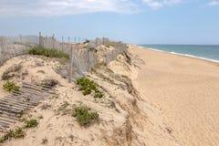 Sand dunes shoreline. On the beach of Faro region, Portugal Royalty Free Stock Photos