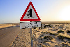 Sand Dunes sign and road Stock Image