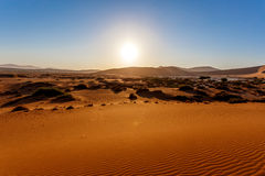 Sand dunes at Sossusvlei, Namibia. Landscape of dunes in sossusvlei, sunrise with wind shapes the sand dunes, Namibia Royalty Free Stock Image