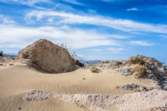 Sand dunes,stones and blue sky Stock Images