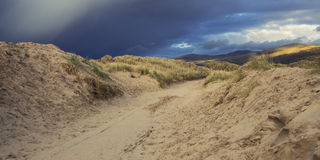 Sand dunes and stormy skies Royalty Free Stock Photo