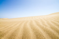 Sand dunes stretching into the distance. Stock Image
