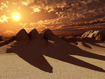 Sand Dunes With Sun. A image of some desert sand dunes with a sun setting Stock Photos
