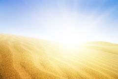 Sand dunes in sunny day. Royalty Free Stock Images