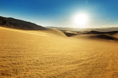 Sand dunes in a sunny sky Stock Image