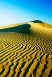 Sand dunes on the sunset Royalty Free Stock Photo