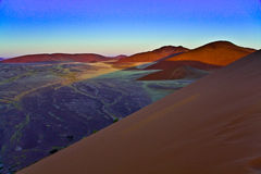 Sand Dunes at Sunset. Huge sand dunes at sunset in Sossusvlei in the Namib Desert, Namibia Royalty Free Stock Image