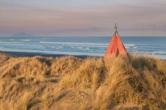 Sand Dunes Tepee. Tepee on a beach sand dune, with earnly morning sunlight Royalty Free Stock Photo