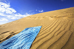 Sand dunes and towel Stock Images