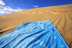 Sand dunes and towel Royalty Free Stock Photography