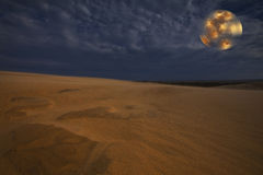 Sand dunes under full moon light Royalty Free Stock Images