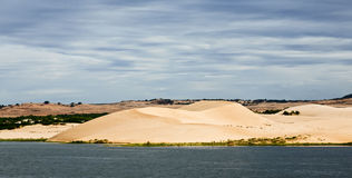 Sand Dunes under Grey Clouds Royalty Free Stock Photos