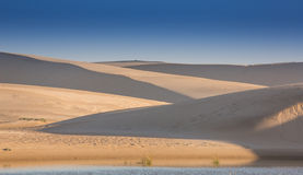 Sand Dunes and Water Stock Image