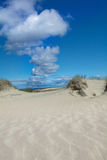 Sand dunes. And white clouds Royalty Free Stock Photography