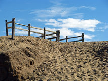 Sand dunes with wooden fencing Stock Photo