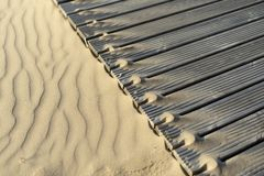 Sand dunes and wooden walkways on the beach royalty free stock photos