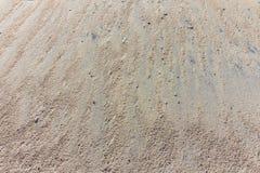 Sand in einem Hintergrund des steilen Hangs Lizenzfreies Stockfoto