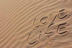 Sand in einer Wüste LIEBES-LEBENSDAUER Stockfotografie
