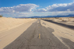 Sand on Empty Desert Road Royalty Free Stock Photography