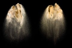 Sand explosion isolated on black background. Freeze motion of sandy dust splash royalty free stock image