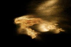 Sand explosion isolated on black background. Freeze motion of  sandy dust splashing.  royalty free stock photo