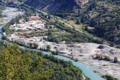 Sand extraction along the french Durance River, Hautes Alpes. Sand dredging Industry in the Hautes Alpes along the Durance river near Champcella. The Durance is stock image