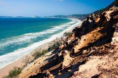 sand för strandblowcarlo regnbåge royaltyfria foton