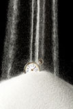 Sand falling on clock Royalty Free Stock Photo