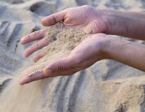 Sand falling from hands Stock Photos