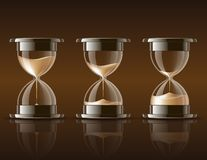 Sand falling in the hourglass. Stock Photos