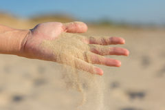 Sand falling from palm Stock Images